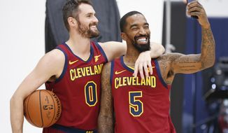 Cleveland Cavaliers' Kevin Love (0) and J.R. Smith (5) take a picture together during the NBA basketball team's media day, Monday, Sept. 24, 2018, in Independence, Ohio. (AP Photo/Ron Schwane)