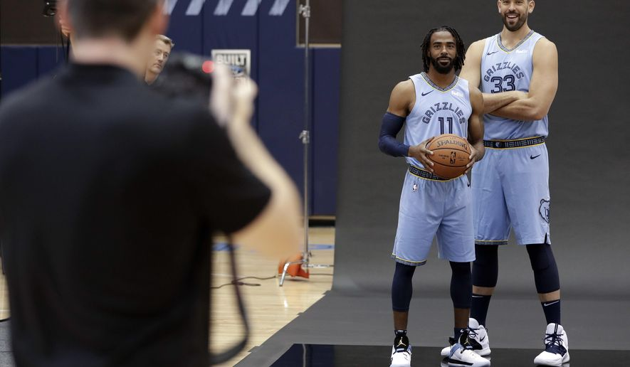 CORRECTS DATE Memphis Grizzlies guard Mike Conley (11) and center Marc Gasol (33) pose during the team's NBA basketball media day Monday, Sept. 24, 2018, in Memphis, Tenn. (AP Photo/Mark Humphrey)