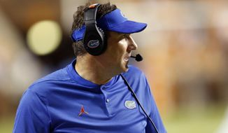 FILE - In this Sept. 22, 2018, file photo, Florida head coach Dan Mullen watches the first half of an NCAA college football game against Tennessee in Knoxville, Tenn. Mullen will forever be tied to Starkville, Miss. It is where he landed his first head coaching job. It is where his two children were born. It is the place he called home for nearly a decade. (AP Photo/Wade Payne, File)