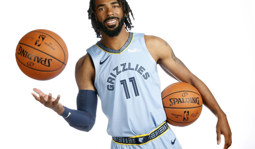 Memphis Grizzlies guard Mike Conley poses during the team's NBA basketball media day Monday, Sept. 24, 2018, in Memphis, Tenn. The Grizzlies have a handful of new faces with Conley back healthy as they try to keep up with an ever tougher Western Conference. (AP Photo/Mark Humphrey)
