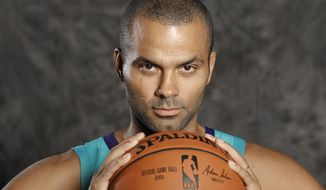 Charlotte Hornets' Tony Parker poses for a photo during the NBA basketball team's media day in Charlotte, N.C., Monday, Sept. 24, 2018. (AP Photo/Chuck Burton)