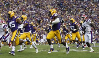 LSU linebacker Devin White (40) returns a fumble in the first half of an NCAA college football game against Louisiana Tech in Baton Rouge, La., Saturday, Sept. 22, 2018. LSU won 38-21. (AP Photo/Tyler Kaufman)