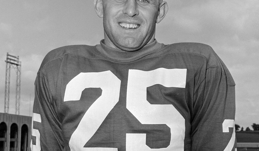 FILE - This is a July 26, 1962, file photo showing Tommy McDonald of the Philadelphia Eagles football team, in Hershey, Penn. Hall of Famer Tommy McDonald has died at 84. His death was announced Monday, Sept. 24, 2018, by the Pro Football Hall of Fame. Details were not disclosed.  (AP Photo/Paul Vathis, File)