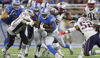 Detroit Lions running back Kerryon Johnson (33) breaks through the New England Patriots line during the second half of an NFL football game, Sunday, Sept. 23, 2018, in Detroit. (AP Photo/Paul Sancya)