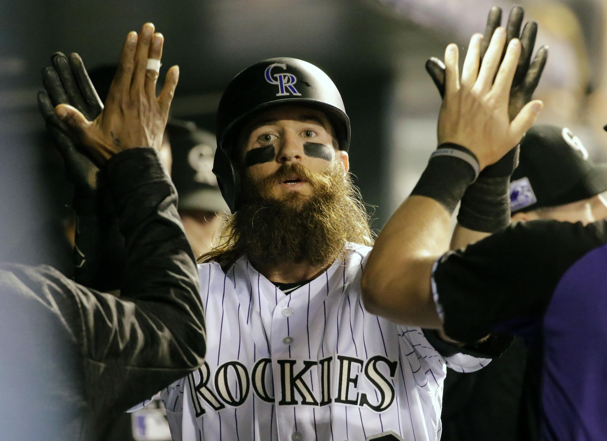 Gray crisp over 7, playoff-chasing Rockies rout Ph...