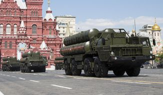 FILE In this file photo taken on Monday, May 9, 2016, Russian the S-300 air defense missile systems drive during the Victory Day military parade marking 71 years after the victory in WWII in Red Square in Moscow, Russia. Moscow will supply the Syrian government with modern S-300 missile defense systems following last week's downing of a Russian plane, the Russian Defense Minister announced on Monday Sept. 24, 2018.(AP Photo/Alexander Zemlianichenko, File)