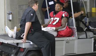 Atlanta Falcons safety Ricardo Allen leaves the game with an injury during the second half against the New Orleans Saints in an NFL football game, Sunday, Sept 23, 2018, in Atlanta. (Curtis Compton/Atlanta Journal-Constitution via AP)