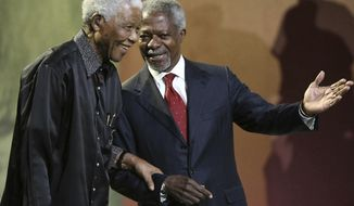 FILE - In this July 22, 2007 file photo, Nelson Mandela and former United Nations Secretary General Kofi Annan arrive together at the 5th annual Nelson Mandela Lecture at the Linder Auditorium in Johannesburg, South Africa. The United Nations is seeking to harness the soaring symbolism of Mandela, whose South African journey from anti-apartheid leader to prisoner to president to global statesman is one of the 20th century's great stories of struggle, sacrifice and reconciliation. The unveiling of a statue of Mandela, born 100 years ago, with arms outstretched at the U.N. building in New York on Monday, Sept. 24, 2018, opens a peace summit at the General Assembly. (AP Photo, File)