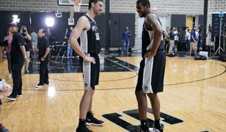 San Antonio Spurs NBA basketball players Pau Gasol, left, and LaMarcus Aldridge talk during media day at the Spurs practice facility in San Antonio, Monday, Sept. 24, 2018. (AP Photo/Darren Abate)