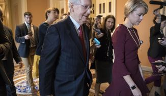 Senate Majority Leader Mitch McConnell, R-Ky., returns to his office after speaking on the Senate floor about Supreme Court nominee Brett Kavanaugh on Capitol Hill in Washington, Monday, Sept. 24, 2018. (AP Photo/J. Scott Applewhite)