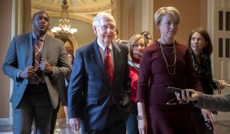 Senate Majority Leader Mitch McConnell, R-Ky., walks to his office after speaking on the Senate floor about Supreme Court nominee Brett Kavanaugh, on Capitol Hill in Washington, Monday, Sept. 24, 2018. (AP Photo/J. Scott Applewhite)