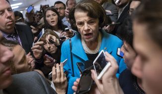 FILE - In this Tuesday, Sept. 18, 2018, file photo, Sen. Dianne Feinstein, D-Calif., the ranking member on the Senate Judiciary Committee, responds to reporters' questions on Supreme Court nominee Brett Kavanaugh amid scrutiny of a woman's claim he sexually assaulted her at a party when they were in high school, on Capitol Hill in Washington. (AP Photo/J. Scott Applewhite, File)
