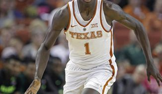 FILE - In this March 4, 2017, file photo, Texas guard Andrew Jones dribbles the ball during the second half of an NCAA college basketball game against Baylor, in Austin, Texas. Jones, who is battling leukemia, is practicing with the Longhorns but is still held out of some drills as he continues to regain strength, coach Shaka Smart said Monday, Sept. 24, 2018. (AP Photo/Michael Thomas, File)