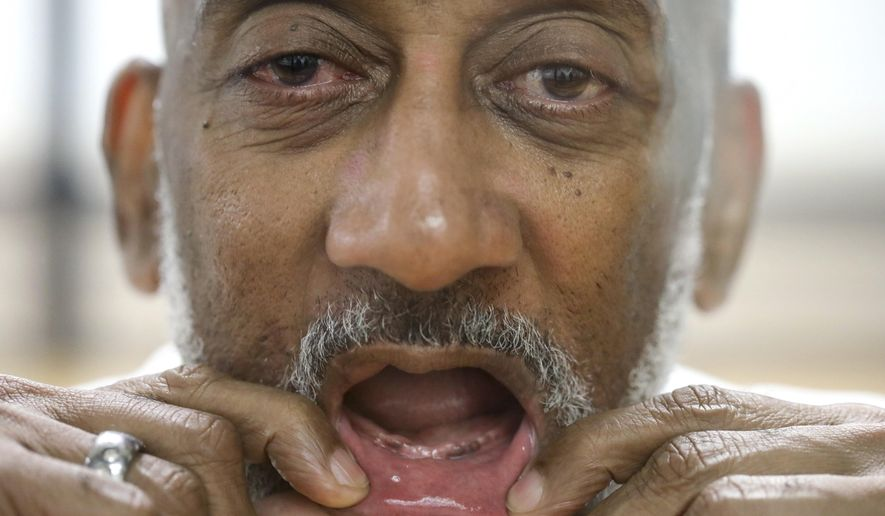 In this Sept. 14, 2018, photo David Ford, an inmate at the Huntsville Unit, who has had trouble getting dentures while in prison, shows his mouth while posing for a photo in Huntsville, Texas. Inmates without teeth in Texas are routinely denied dentures because state prison policy says chewing isn't a medical necessity and that they can eat blended food. (Jon Shapley/Houston Chronicle via AP)