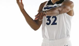 Minnesota Timberwolves' Karl-Anthony Towns, who signed a $190 million, five-year contract extension, poses for a photo during the NBA basketball team's media day at Target Center, Monday, Sept. 24, 2018, in Minneapolis. (AP Photo/Jim Mone)