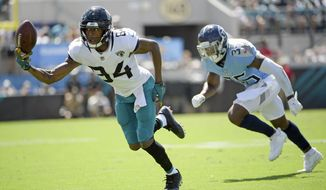 Jacksonville Jaguars wide receiver Keelan Cole (84) lets a pass slip away as he is defended by Tennessee Titans cornerback LeShaun Sims (36) during the first half of an NFL football game, Sunday, Sept. 23, 2018, in Jacksonville, Fla. (AP Photo/Phelan M. Ebenhack)