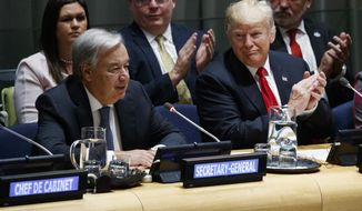 President Donald Trump listens as United Nations Secretary General Antonio Guterres speaks at the United Nations General Assembly, Monday, Sept. 24, 2018, at U.N. Headquarters. (AP Photo/Evan Vucci)