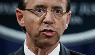 FILE - In this July 13, 2018 file photo, Deputy Attorney General Rod Rosenstein speaks during a news conference at the Department of Justice in Washington. Rosenstein is expecting to be fired, heading to White House Monday morning.(AP Photo/Evan Vucci)
