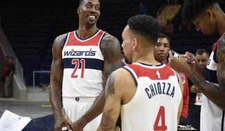 Washington Wizards' Dwight Howard stands near to Chris Chiozza (4) during an NBA basketball media day, Monday, Sept. 24, 2018, in Washington. (AP Photo/Nick Wass)