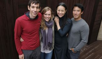 "In this Sept. 10, 2018 photo, climbers Alex Honnold, from left, and Sanni McCandless, subjects of the documentary film ""Free Solo,"" pose with co-directors Elizabeth Chai Vasarhelyi and Jimmy Chin at the InterContinental Hotel during the Toronto International Film Festival in Toronto. (Photo by Chris Pizzello/Invision/AP)"