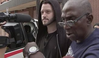 In this image made from a Sunday, Sept. 23, 2018, video by KTRK-TV, Cody Wilson walks out of the Harris County Jail in Houston. Wilson, the owner of a Texas company that sells plans to make untraceable 3-D printed guns, is free on bond after being accused by authorities of having sex with an underage girl. (KTRK-TV via AP)