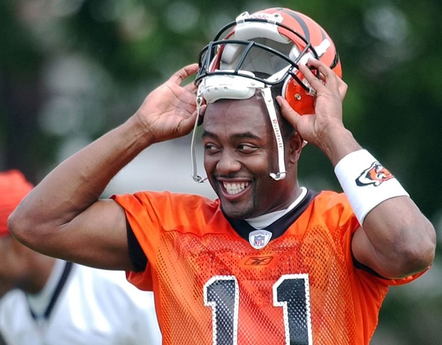 18. Akili Smith - Cincinnati Bengals (No. 3 overall 1999 NFL Draft)   Cincinnati Bengals quarterback Akili Smith smiles during  practice, Friday, July 26, 2002, at the team's training camp in Georgetown, Ky. (AP Photo/Al Behrman)
