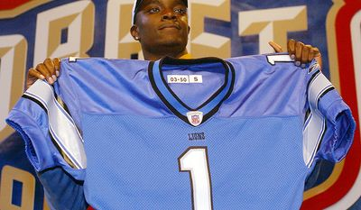 4. Charles Rogers - Detroit Lions (No. 2 overall selection 2003 NFL Draft)   Charles Rogers, a wide receiver from Michigan State, holds up a Detroit Lions jersey after he was selected as the Lions first pick, second pick overall, at the NFL draft Saturday, April 26, 2003 in New York. (AP Photo/Ed Betz)
