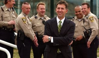Attorney for the alleged victim in the Kobe Bryant sexual assault case, John Clune, center, laughs as he chats with members of the Eagle County Sheriffs department outside the Eagle County Courthouse, Wednesday March 24, 2004, in Eagle, Colorado. Clune's client testified about her sex life for more than three hours Wednesday during a closed-door hearing that will determine whether any of the information can be introduced at the NBA star's rape trial. (AP Photo/Peter Fredin)