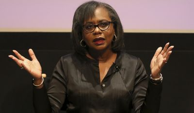 Anita Hill applauds at the Anita Hill and Fatima Goss Graves Discussion on Harassment at United Talent Agency on Friday, Dec. 8, 2017, in Beverly Hills, Calif. (Photo by Willy Sanjuan/Invision/AP)