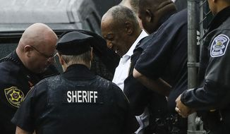 Bill Cosby departs from his sentencing hearing at the Montgomery County Courthouse, Tuesday, Sept. 25, 2018, in Norristown Pa. Cosby left in handcuffs to begin serving a three-to-10 year prison sentence for sexual assault. (AP Photo/Matt Rourke)