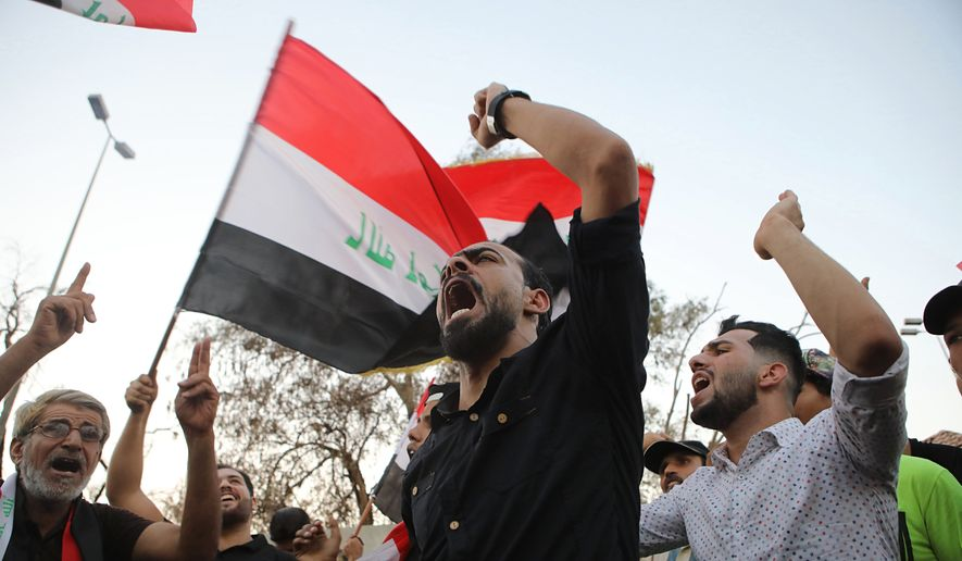 Demonstrators wave national flags and chant slogans during a demonstration demanding better public services and jobs in the southern city of Basra, Iraq, Tuesday, Sept. 25, 2018. (AP Photo/Nabil al-Jurani) ** FILE **
