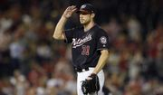 Washington Nationals starting pitcher Max Scherzer gestures from the mound after he recorded his 300th strikeout of the season during the seventh inning of a baseball game against the Miami Marlins, Tuesday, Sept. 25, 2018, in Washington. (AP Photo/Nick Wass)