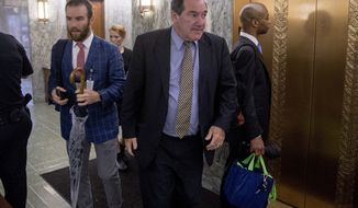 Sen. Joe Donnelly, D-Ind., center, arrives on Capitol Hill in Washington, Tuesday, Sept. 25, 2018. (AP Photo/Andrew Harnik) **FILE**