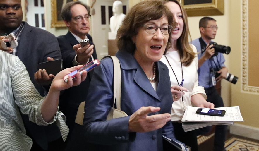 Sen. Susan Collins, R-Maine, center, walks with journalists as she departs the Republican policy luncheon, on Capitol Hill, Tuesday, Sept. 25, 2018 in Washington. (AP Photo/Alex Brandon)