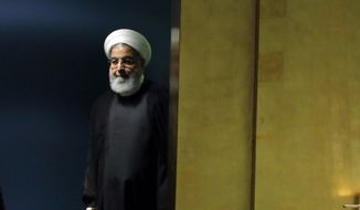 Iran's President Hassan Rouhani arrives to address the 73rd session of the United Nations General Assembly, at U.N. headquarters, Tuesday, Sept. 25, 2018. (AP Photo/Richard Drew)