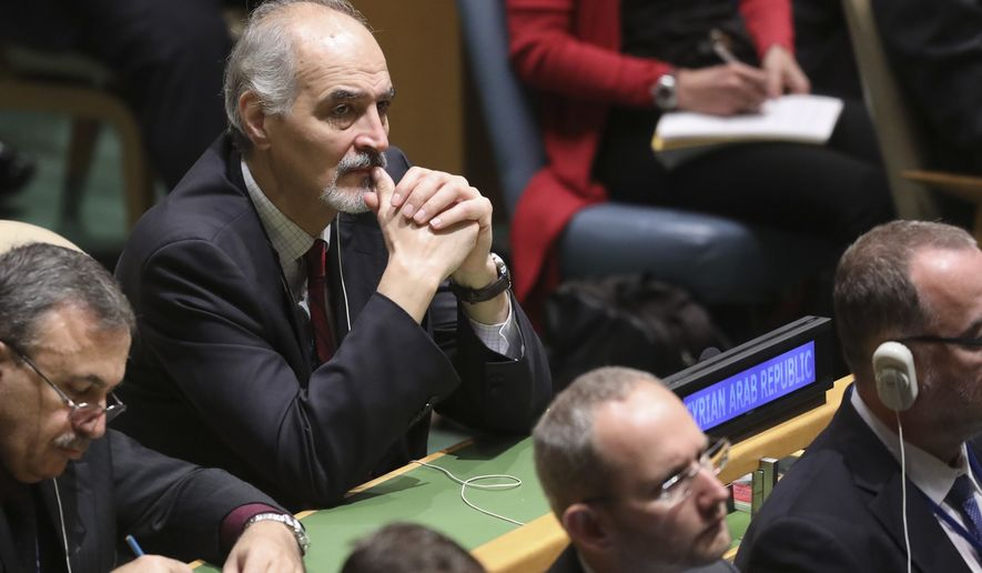 Syria's United Nations Ambassador Bashar Jaafari, center, listens as President Donald Trump address the United Nations General Assembly, Tuesday Sept. 25, 2018 at U.N. headquarters. (AP Photo/Bebeto Matthews)