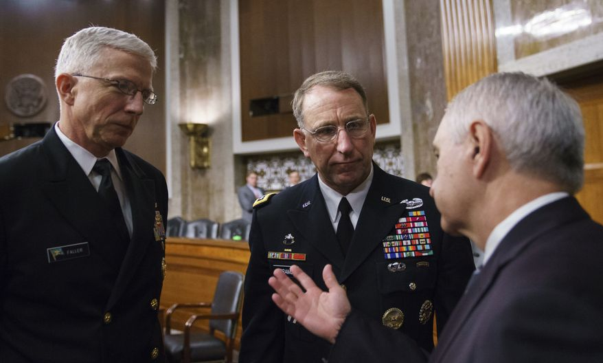 Gen. Robert Abrams, center, and Navy Vice Adm. Craig Faller, left, talks with Senate Armed Services Committee ranking member Sen. Jack Reed, D-R.I., after a hearing on Capitol Hill in Washington, Tuesday, Sept. 25, 2018. Gen. Abrams is nominated to take command of U.S. and allied forces in South Korea and Navy Vice Adm. Faller is nominated to take over U.S. Southern Command. Gen. Abrams says the decision to cancel several major military exercises on the Korean peninsula this year caused a slight degradation in the readiness of American forces. (AP Photo/Carolyn Kaster)