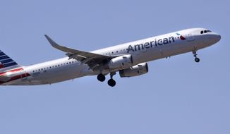 In this May 24, 2018, file photo, an American Airlines passenger jet plane, an Airbus A321 model, approaches Logan Airport in Boston. On March 28, 2019, the airline announced it was indefinitely suspending service to Venezuela. (AP Photo/Charles Krupa, File) **FILE**
