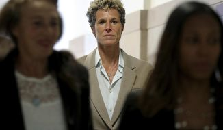 Accuser Andrea Constand returns to the courtroom during a lunch break at the sentencing hearing for Bill Cosby at the Montgomery County Courthouse in Norristown, Pa., Monday, Sept. 24, 2018. (David Maialetti/The Philadelphia Inquirer via AP, Pool)