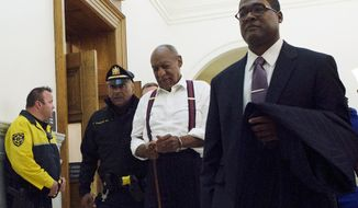 Bill Cosby, center, leaves the courtroom after he was sentenced to three-to 10-years for felony sexual assault on Tuesday, Sept. 25, 2018, in Norristown, Pa. (Mark Makela/Pool Photo via AP)