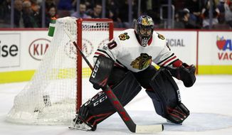 FILE - In this Nov. 9, 2017, file photo, Chicago Blackhawks' Corey Crawford guards the net during an NHL hockey game against the Philadelphia Flyers, in Philadelphia .For all the talk about Corey Crawford and the aging core of the Chicago Blackhawks, coach Joel Quenneville delivered a simple message as the team got back together for the start of a season that could have a dramatic impact on the direction of the franchise. Bring it, all the time. (AP Photo/Matt Slocum, File)