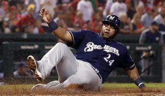 Milwaukee Brewers' Jesus Aguilar scores during the sixth inning of a baseball game against the St. Louis Cardinals, Monday, Sept. 24, 2018, in St. Louis. (AP Photo/Jeff Roberson)