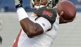 FILE - In this Aug. 28, 2018, file photo, Tampa Bay Buccaneers quarterback Jameis Winston warms up before a preseason NFL football game against the Tennessee Titans, in Nashville, Tenn. Winston's suspension is over. The question is will he return as the No. 1 quarterback of the Tampa Bay Buccaneers, who are off to a 2-1 start with Ryan Fitzpatrick throwing for more than 400 yards in each game. (AP Photo/Mark Zaleski, File)