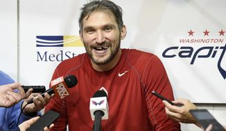 FILE - In this Sept. 14, 2018, file photo, Washington Capitals' Alex Ovechkin, of Russia, laughs as he talks to the media at NHL hockey training camp, in Arlington, Va. Coming off scoring an NHL-best 49 goals and winning the Conn Smythe Trophy as playoff MVP, Ovechkin has nothing left to prove as one of the best players of this generation. (AP Photo/Nick Wass, File)