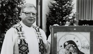 This 1989 file photo shows Father Arthur Perrault in Albuquerque, N.M. Perrault, a fugitive priest who fled the U.S. decades ago amid allegations of child sex abuse has been returned to New Mexico to face charges after being arrested in Morocco last year, federal officials said Friday, Sept. 21, 2018. (The Albuquerque Journal via AP, File)