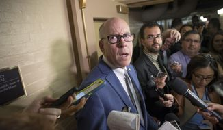 In this July 28, 2017, photo, House Energy and Commerce Committee Chairman Rep. Greg Walden, R-Ore., is surrounded by reporters on Capitol Hill in Washington. (AP Photo/J. Scott Applewhite) **FILE**