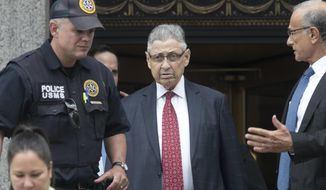 FILE - In this July 27, 2018 file photo, former New York Assembly Speaker Sheldon Silver, center, leaves federal court in New York after his sentencing. Federal appeals court judge Peter Hall said Tuesday, Sept. 25 that Silver might not have to report to prison until a judicial panel decides if he can remain free on bail while he appeals.  Silver was sentenced to seven years in prison after he was convicted earlier this year of accepting nearly $4 million in return for legislative favors. (AP Photo/Mary Altaffer, File)