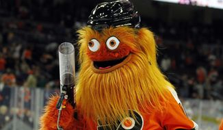 "FILE - In this Sept. 24, 2018, file photo, the Philadelphia Flyers new mascot, Gritty, takes to the ice during the first intermission of the Flyers' preseason NHL hockey game against the Boston Bruins,in Philadelphia. The character's debut triggered an outpouring of comments online, including ""Good luck sleeping tonight, Flyers fans"" and comparisons to ZZ Top and the Muppets. (AP Photo/Tom Mihalek, File)"