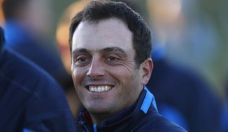 Europe's Francesco Molinari smiles as he prepares for the European Ryder Cup team photo at Le Golf National in Guyancourt, outside Paris, France, Tuesday, Sept. 25, 2018. The 42nd Ryder Cup will be held in France from Sept. 28-30, 2018 at Le Golf National. (AP Photo/Alastair Grant)