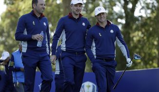 Europe's Sergio Garcia, Justin Rose and Alex Noren, from left, walk off the 14th tee during a practice round at Le Golf National in Guyancourt, outside Paris, France, Tuesday, Sept. 25, 2018. The 42nd Ryder Cup will be held in France from Sept. 28-30, 2018 at Le Golf National. (AP Photo/Matt Dunham)